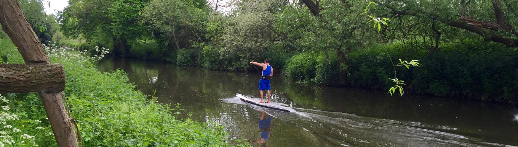 Paddle boarding down the River Wey