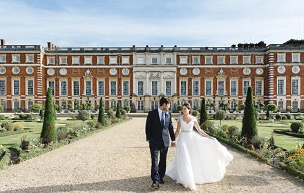 Bride and Groom in Hampton Palace Court grounds